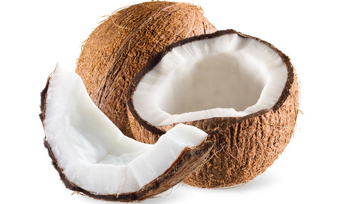 coconut with half and piece isolated on white